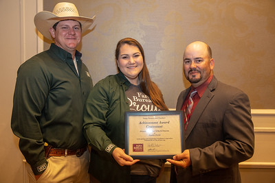 2019 Louisiana Farm Bureau Young Farmers and Ranchers Achievement Award finalist Robert and Rachel Duncan of Rapides Parish receives their recognition certificate from Louisiana Farm Bureau Young Farmers and Ranchers state chair Matt Gravois at the 97th Annual Convention of the Louisiana Farm Bureau Federation in New Orleans.