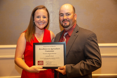 2019 Louisiana Farm Bureau Young Farmers and Rancher Excellence in Agriculture contestant Mariah Simoneaux of Assumption Parish receives her recognition certificate from Louisiana Farm Bureau Young Farmers and Ranchers state chair Matt Gravois at the 97th Annual Convention of the Louisiana Farm Bureau Federation in New Orleans.