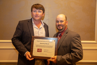 Kody Beavers of Franklin Parish receives the 2019 Award of Merit from Louisiana Farm Bureau Young Farmers and Ranchers state chair Matt Gravois, on behalf of the Franklin Parish Farm Bureau Young Farmers and Ranchers committee.