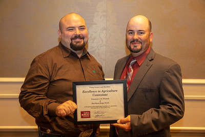 2019 Louisiana Farm Bureau Young Farmers and Rancher Excellence in Agriculture contestant Vic Womack of East Baton Rouge Parish receives his recognition certificate from Louisiana Farm Bureau Young Farmers and Ranchers state chair Matt Gravois at the 97th Annual Convention of the Louisiana Farm Bureau Federation in New Orleans.