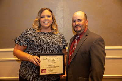 2019 Louisiana Farm Bureau Young Farmers and Rancher Excellence in Agriculture contestant Camry Martin of Tangipahoa Parish receives her recognition certificate from Louisiana Farm Bureau Young Farmers and Ranchers state chair Matt Gravois at the 97th Annual Convention of the Louisiana Farm Bureau Federation in New Orleans.