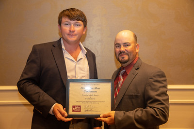 2019 Louisiana Farm Bureau Young Farmers and Rancher Discussion Meet contestant Kody Beavers of Franklin Parish receives his recognition certificate from Louisiana Farm Bureau Young Farmers and Ranchers state chair Matt Gravois at the 97th Annual Convention of the Louisiana Farm Bureau Federation in New Orleans.