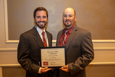 2019 Louisiana Farm Bureau Young Farmers and Rancher Discussion Meet contestant Aaron Olivier of St. Landry Parish receives his recognition certificate from Louisiana Farm Bureau Young Farmers and Ranchers state chair Matt Gravois at the 97th Annual Convention of the Louisiana Farm Bureau Federation in New Orleans.