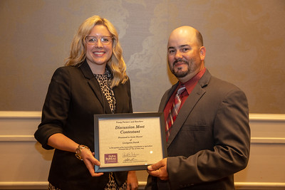 2019 Louisiana Farm Bureau Young Farmers and Rancher Discussion Meet contestant jessie Hoover of Livingston Parish receives his recognition certificate from Louisiana Farm Bureau Young Farmers and Ranchers state chair Matt Gravois at the 97th Annual Convention of the Louisiana Farm Bureau Federation in New Orleans.