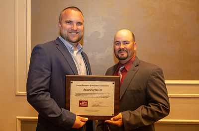 Adam Caughern of Caddo Parish receives the 2019 Award of Merit from Louisiana Farm Bureau Young Farmers and Ranchers state chair Matt Gravois, on behalf of the Caddo Parish Farm Bureau Young Farmers and Ranchers committee.