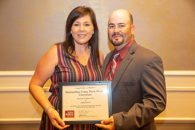 2019 Louisiana Farm Bureau Young Farmers and Ranchers Outstanding Young Farm Woman contestant Megan Cook of Sabine Parish receives her recognition certificate from Louisiana Farm Bureau Young Farmers and Ranchers state chair Matt Gravois at the 97th Annual Convention of the Louisiana Farm Bureau Federation in New Orleans.