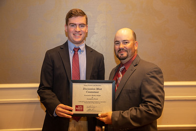 2019 Louisiana Farm Bureau Young Farmers and Rancher Discussion Meet contestant Wesley Adolph of Assumption Parish receives his recognition certificate from Louisiana Farm Bureau Young Farmers and Ranchers state chair Matt Gravois at the 97th Annual Convention of the Louisiana Farm Bureau Federation in New Orleans.