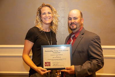 2019 Louisiana Farm Bureau Young Farmers and Ranchers Outstanding Young Farm Woman contestant Carey Tomlinson of East Carroll Parish receives her recognition certificate from Louisiana Farm Bureau Young Farmers and Ranchers state chair Matt Gravois at the 97th Annual Convention of the Louisiana Farm Bureau Federation in New Orleans.