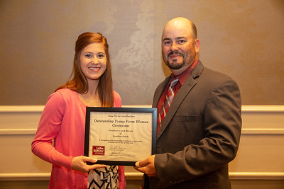 2019 Louisiana Farm Bureau Young Farmers and Ranchers Outstanding Young Farm Woman contestant Leah McLain of Vermillion Parish receives her recognition certificate from Louisiana Farm Bureau Young Farmers and Ranchers state chair Matt Gravois at the 97th Annual Convention of the Louisiana Farm Bureau Federation in New Orleans.