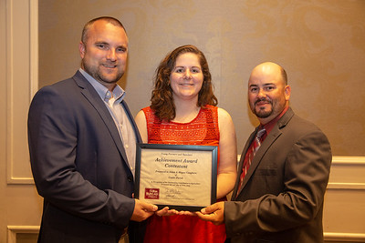 2019 Louisiana Farm Bureau Young Farmers and Ranchers Achievement Award finalist Adam and Megan Caughern of Caddo Parish receives their recognition certificate from Louisiana Farm Bureau Young Farmers and Ranchers state chair Matt Gravois at the 97th Annual Convention of the Louisiana Farm Bureau Federation in New Orleans.