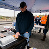 Wayne Beauregard, of the Columbia Tavern, mans the grill during the inaugural bocce tournament between the Leominster Fire Association and Leominster Police Association in Leominster on Saturday morning. SENTINEL & ENTERPRISE / Ashley Green