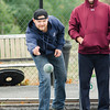 Event organizer Dan Contois plays in the inaugural bocce tournament between the Leominster Fire Association and Leominster Police Association on Saturday morning. SENTINEL & ENTERPRISE / Ashley Green