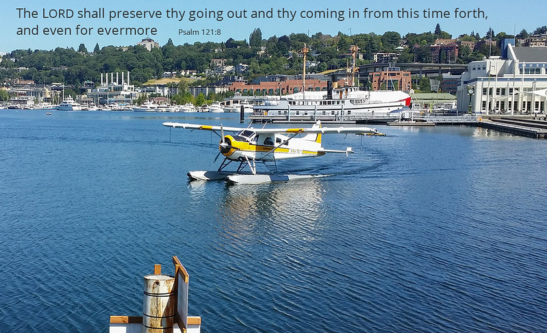 Float plane arriving on Lake Union, with Naval Reserve Building and Historic Ships Wharf in distance on the right.   Photo by Carl Crawford, Mukilteo, Washington.