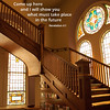 Afternoon sunlight streaming in through stained glass windows, casting a golden glow over a wooden staircase at the Sacred Heart Eucharistic Adoration Chapel in Cullman, Alabama