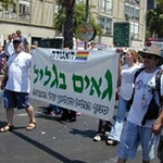 a Gay Galilee flag at the Tel Aviv Pride Parade as part of an organized road trip from Kiryat Shmona
