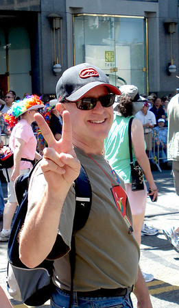 Incredible Human Resource Director, Steve Leibman shows his support for Pride by walking with the Contingent and waves a peace sign!