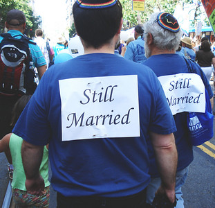 """A photo of two Jewish men, David Preston and Michael Lipsie, from Shir Hadash in San Jose wearing signs stating, """"Still Married"""" with from the Jews March for Pride contingent in the 2009 San Francisco Pride Parade provided by Jasmine Blanchard, Jewish Community Federation ECEI Associate."""
