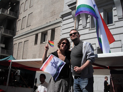 Our Director of the LGBT Alliance, Lisa Finkelstein, with rock star volunteer David Zeeman, after successfully securing the flag to the booth.