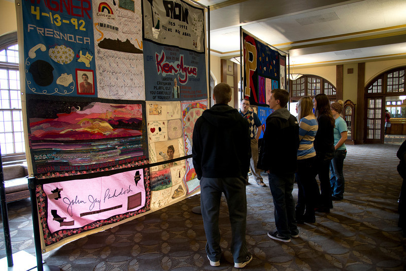 AIDS Awareness Week featured sections of the AIDS Memorial Quilt with Purdue connections on display in the Memorial Union PMU. Lowell Kane, director of Purdue's Lesbian Gay Bisexual Transgender and Queer (LGBTQ) Center, explains the history and significance of the Quilt to students (Purdue University/ Mark Simons)