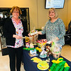 Celeste Karanas of Billerica, left, doles out some dough for daffodils from Auxiliary's Janet Leggat of Lowell at Saints campus.