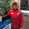 Driving Diva Angelica Louis of Lowell mans the valet booth at the Saints campus.