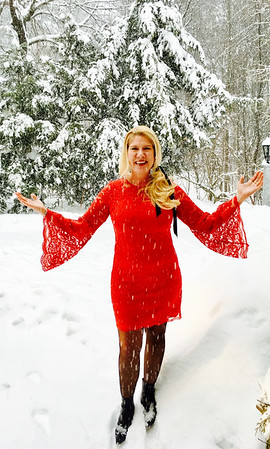 Snow Angel: Frolicking in the snow, I'm wearing a red lace dress with huge bell sleeves and a pair of Manolo's black ankle boots. Back in style are the basic ribbon in your hair, which I have used not only in my side ponytail, but previously as a choker. All the Divine Divas all had a touch of flair, with chunky necklaces, beautiful cocktail dresses, toasty fashionable sweaters and shawls. Despite the blizzard, they all managed to look delightful not only on the outside but on the inside, too, which is most important! Stay safe and warm everyone!