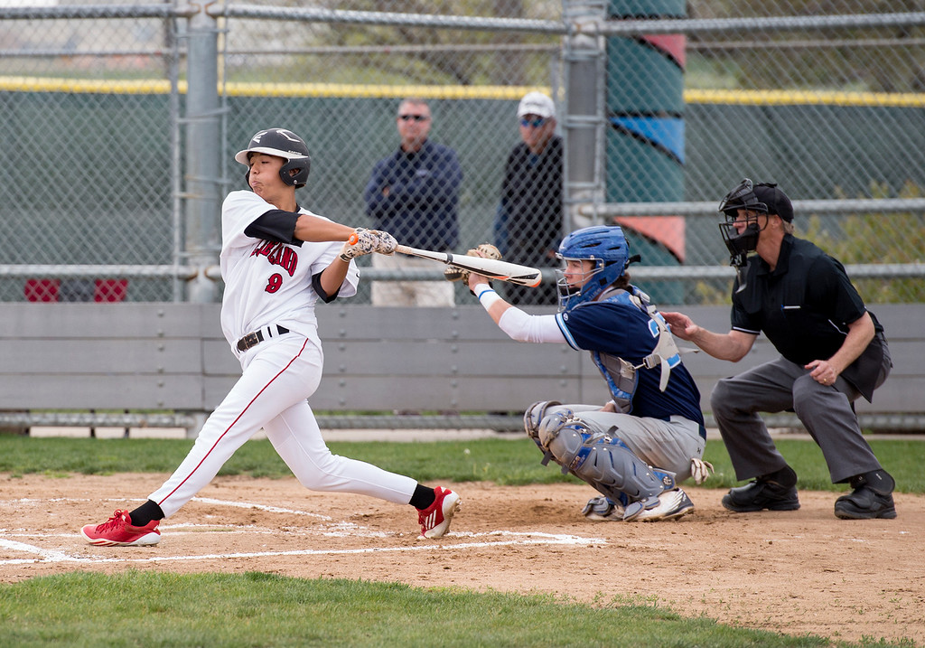 . Loveland pitcher Jordan Cabrera (9) swings and misses during a strike-out Tuesday afternoon May 10, 2016, as the Indians faced Ralston Valley at Centennial Park in Loveland. (Photo by Michael Brian/Loveland Reporter-Herald)