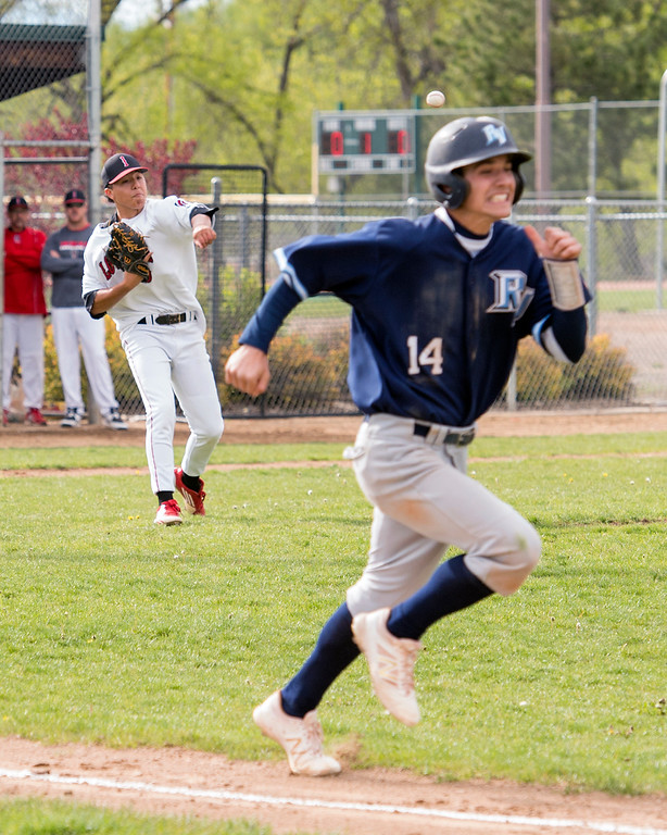 . Loveland pitcher Jordan Cabrera (9) throws out Ralston Valley\'s Josh Robsinson (14) at first base Tuesday afternoon May 10, 2016 at Centennial Park in Loveland. (Photo by Michael Brian/Loveland Reporter-Herald)