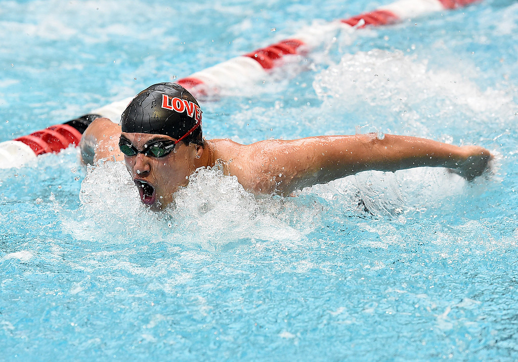 . Loveland High\'s Logan Jacobs swims the 100 yard butterfly Friday, May 12, 2017, during the Front Range League Championships at Veterans Memorial Aquatic Center in Thornton. (Photo by Jenny Sparks/Loveland Reporter-Herald)