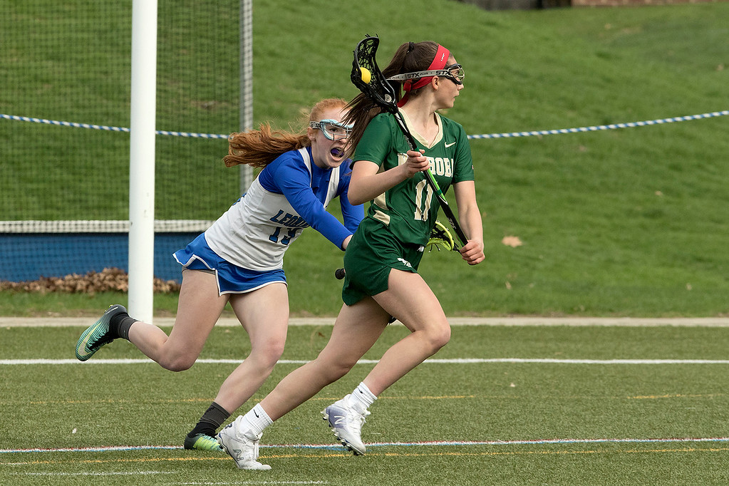 ". Nashoba Regional High School girls lacrosse played Leominster High School at Doyle Field in Leominster on Tuesday, April 30, 2019. LHS\'s Sorcha O""Malley tries to stop NRHS Straface Graham during action in the game. SENTINEL & ENTERPRISE/JOHN LOVE"