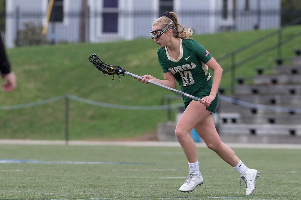. Nashoba Regional High School girls lacrosse played Leominster High School at Doyle Field in Leominster on Tuesday, April 30, 2019. NRHS\'s Julia Sidopoulos gets control of the ball. SENTINEL & ENTERPRISE/JOHN LOVE