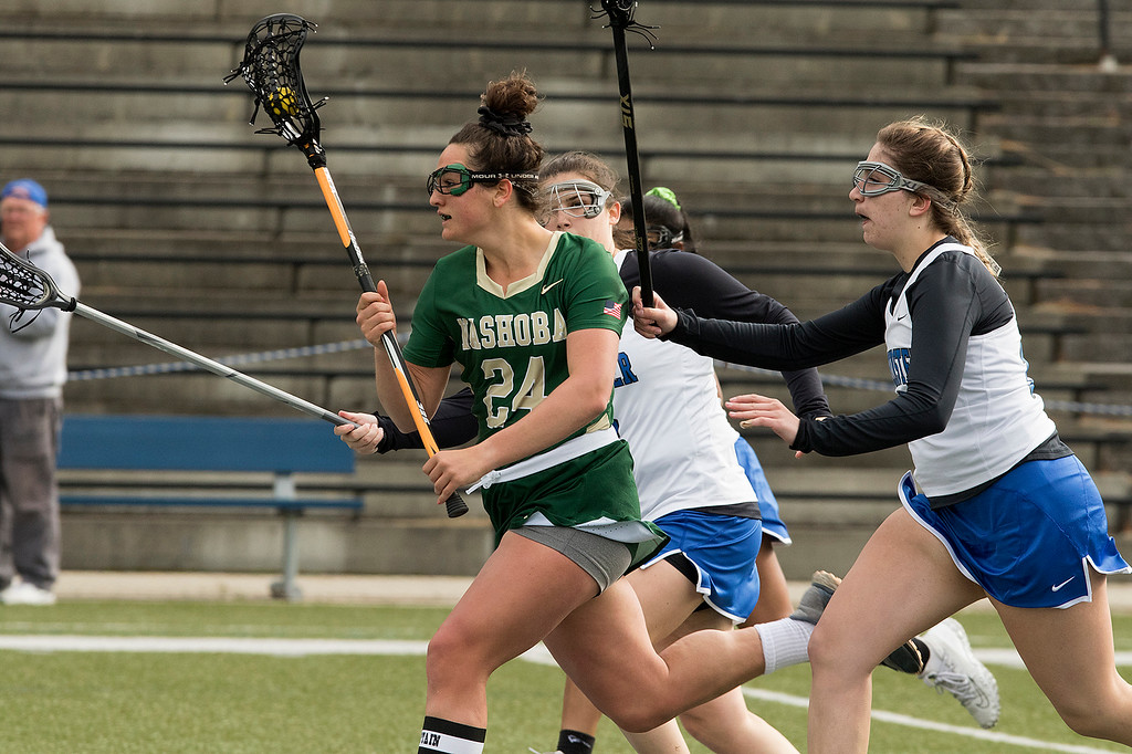. Nashoba Regional High School girls lacrosse played Leominster High School at Doyle Field in Leominster on Tuesday, April 30, 2019. LHS\'s Kaylee Doiron tries to stop NRHS\'s Gillian Fay as she takes off down field with the ball. SENTINEL & ENTERPRISE/JOHN LOVE
