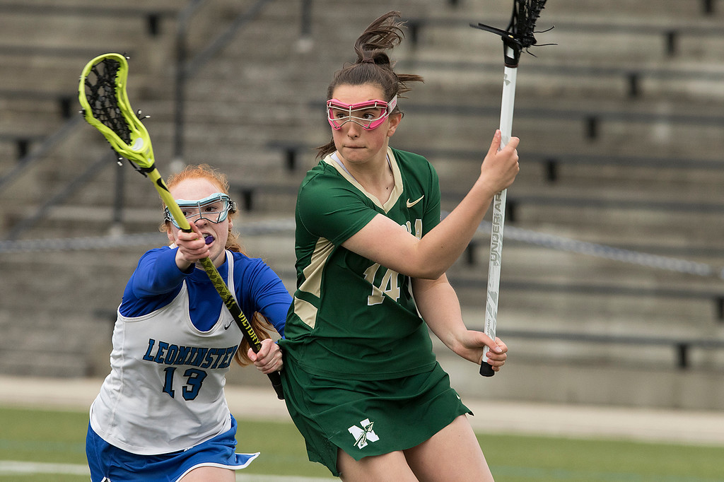 . Nashoba Regional High School girls lacrosse played Leominster High School at Doyle Field in Leominster on Tuesday, April 30, 2019. NRHS\'s Taylor Riley makes some moves as she is covered by LHS\'s Sorcha O\'Malley during action in the game. Nashoba won, 13-3. SENTINEL & ENTERPRISE/JOHN LOVE