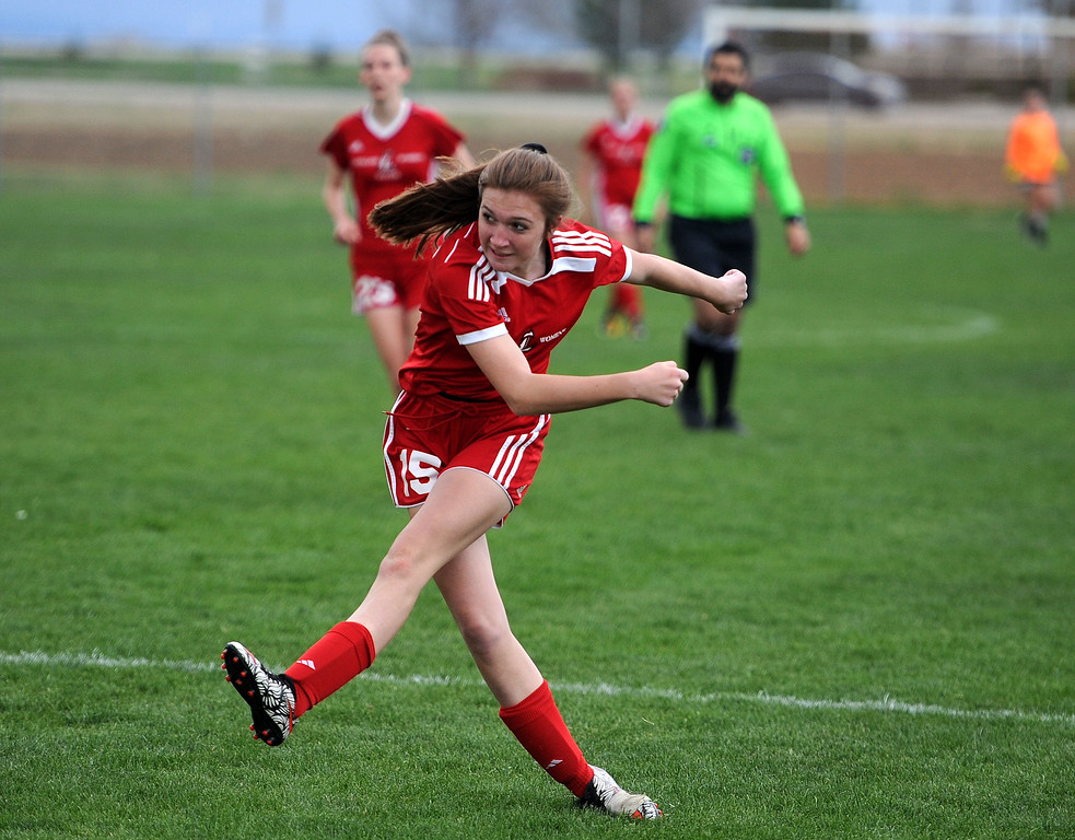 . Carissa Morrison unleases a ball on goal against Frederick on Friday, April 26 at Mountain View Field. Loveland won 5-0. (Colin Barnard/Loveland Reporter-Herald)
