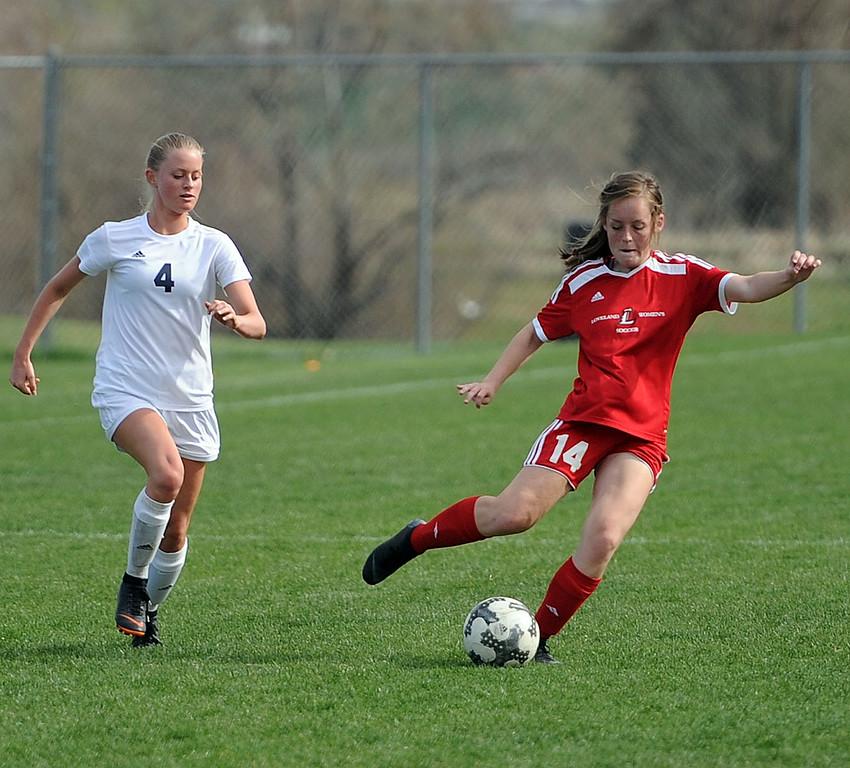 . Abby Amschwand sends a cross to a teammate against Frederick on Thursday, April 26 at Mountain View Field. Loveland won 5-0. (Colin Barnard/Loveland Reporter-Herald)