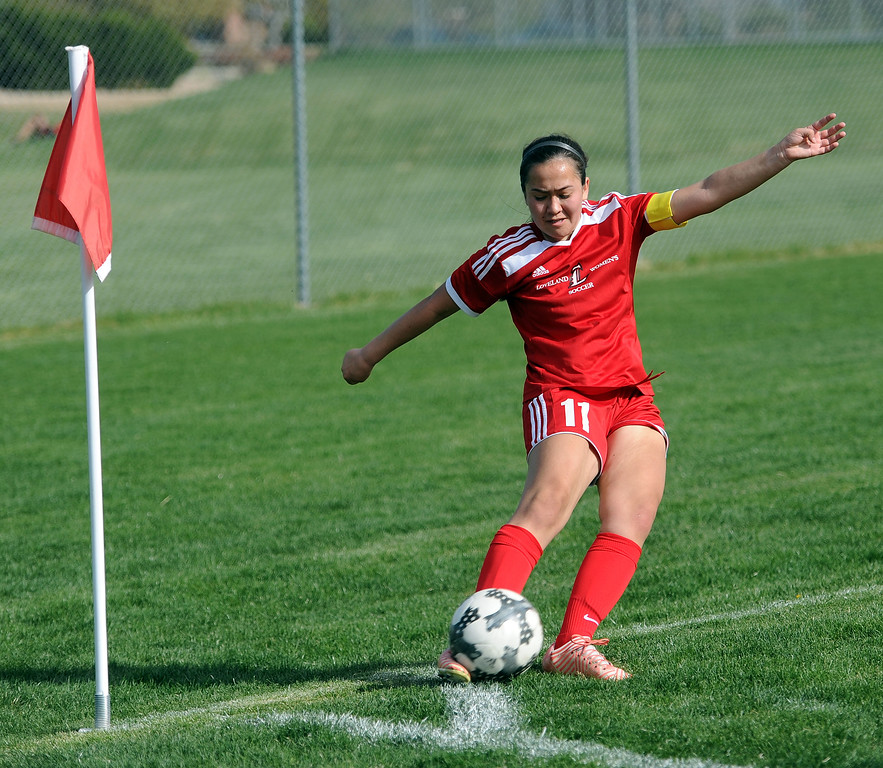 . Megan Stackhouse connects on a corner kick which found the head of Aimee Lee for the Indians\' third goal against Frederick on Friday, April 26 at Mountain View Field. Loveland won 5-0. (Colin Barnard/Loveland Reporter-Herald)