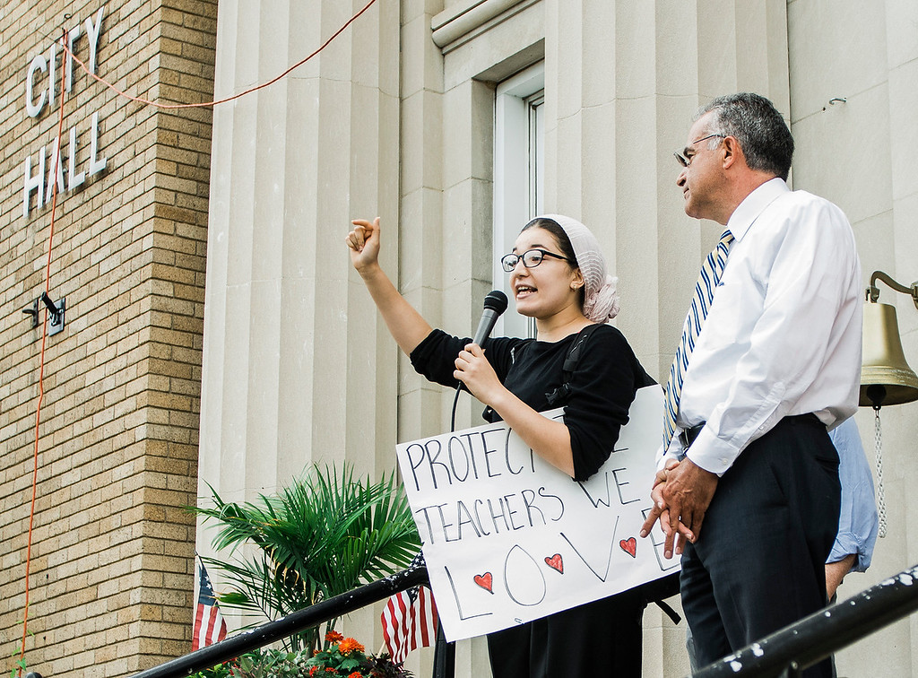 . Sara Ramram speaks as students from Leominster High School walk out of class on Friday, June 16, 2017 to protest the nearly 100 school district faculty and staff that are facing layoffs because of a $5.6 million school district budget deficit. The protest moved as far as City Hall where they were greeted by Mayor Dean Mazzarella. SENTINEL & ENTERPRISE / Ashley Green