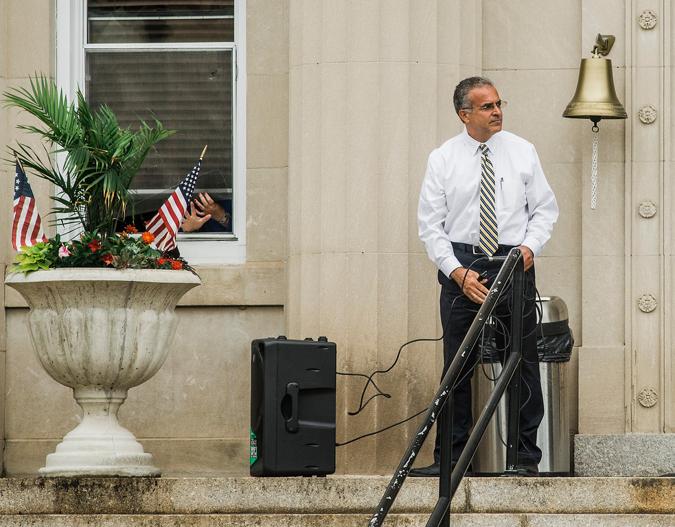 . Mayor Dean Mazzarella sets up a speakers and microphone as students at Leominster High School walk out of class on Friday, June 16, 2017 to protest the nearly 100 school district faculty and staff that are facing layoffs because of a $5.6 million school district budget deficit. The protest moved as far as City Hall where they were greeted by Mayor Dean Mazzarella. SENTINEL & ENTERPRISE / Ashley Green