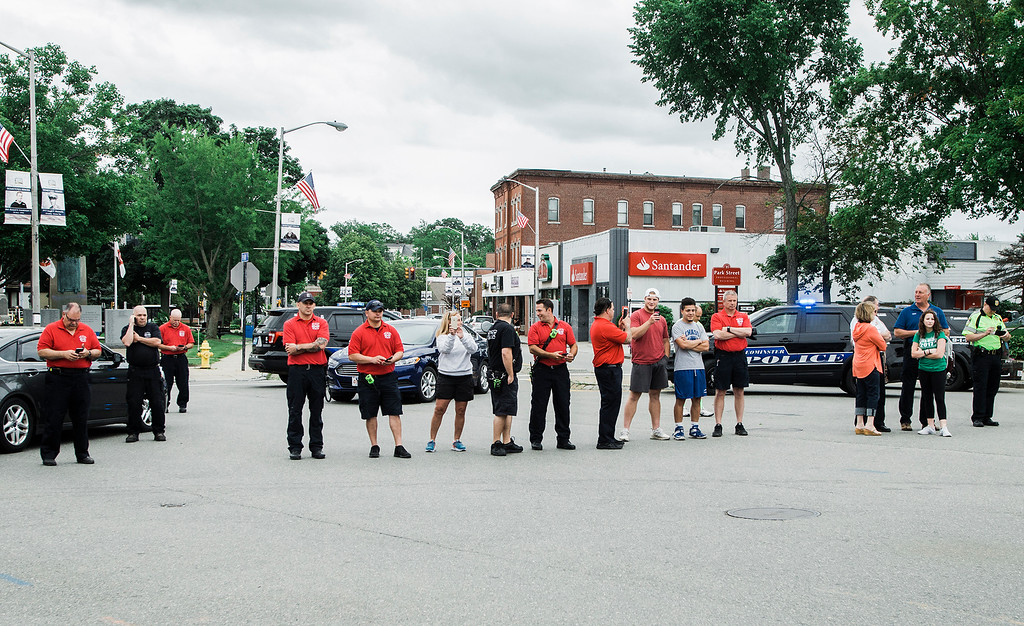 . Authorities block of the downtown as students from Leominster High School walk out of class on Friday, June 16, 2017 to protest the nearly 100 school district faculty and staff that are facing layoffs because of a $5.6 million school district budget deficit. The protest moved as far as City Hall where they were greeted by Mayor Dean Mazzarella. SENTINEL & ENTERPRISE / Ashley Green