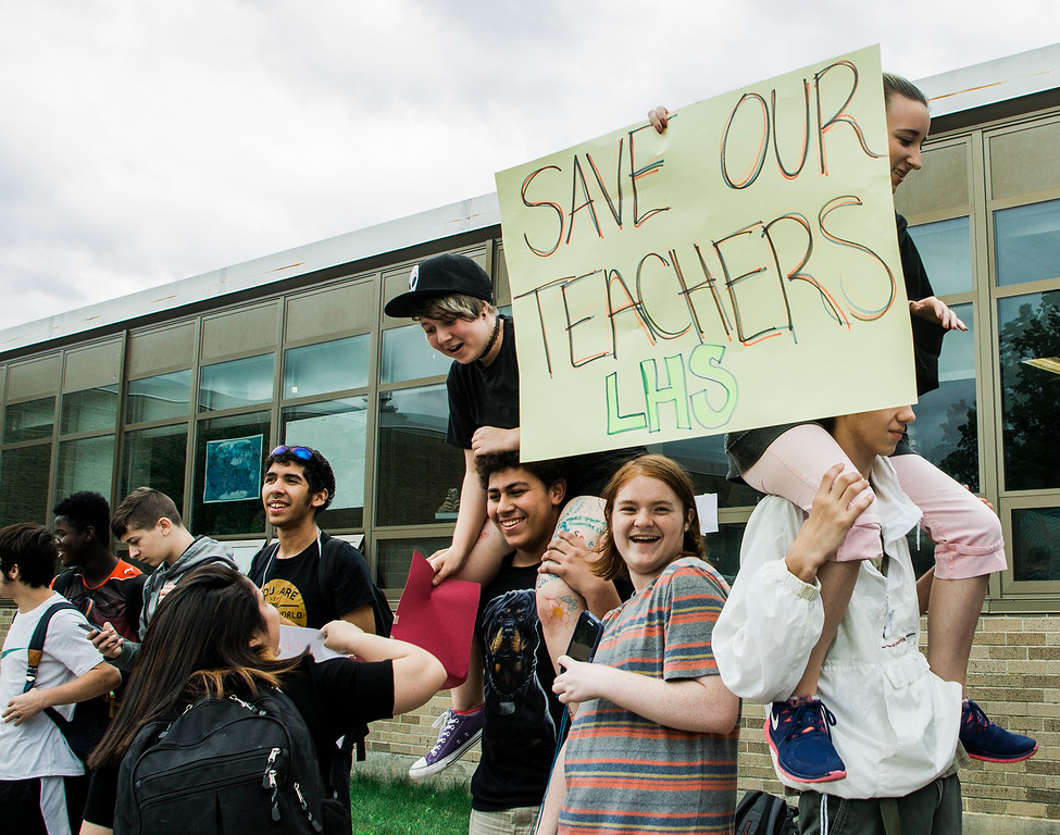 . Students at Leominster High School walk out of class on Friday, June 16, 2017 to protest the nearly 100 school district faculty and staff that are facing layoffs because of a $5.6 million school district budget deficit. The protest moved as far as City Hall where they were greeted by Mayor Dean Mazzarella. SENTINEL & ENTERPRISE / Ashley Green