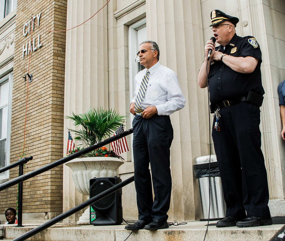 . Acting Police Chief Michael Goldman speaks as students at Leominster High School walk out of class on Friday, June 16, 2017 to protest the nearly 100 school district faculty and staff that are facing layoffs because of a $5.6 million school district budget deficit. The protest moved as far as City Hall where they were greeted by Mayor Dean Mazzarella. SENTINEL & ENTERPRISE / Ashley Green