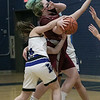 Fitchburg High School girls basketball played Leominster High School on Monday January 25, 2021 in Leominster. FHS's #42 Annika Hoecker drives to the basket but is stopped by LHS's #10 Laura Young. SENTINEL & ENTERPRISE/JOHN LOVE