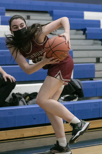 Fitchburg High School girls basketball played Leominster High School on Monday January 25, 2021 in Leominster. Saving the ball from going out of bounds is FHS's #33 Mia Cavins. SENTINEL & ENTERPRISE/JOHN LOVE