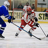 Leominster High School Hockey played Fitchburg/Monty Tech during the Mark Bushnoe Memorial Christmas Tournament on Thursday, December 27, 2018 at the Wallace Civic Center, Fitchburg. LHS's Zack Heleneius tries to stop Fitchburg's Max Beaulac. SENTINEL & ENTERPRISE/JOHN LOVE