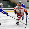 Leominster High School Hockey played Fitchburg/Monty Tech during the Mark Bushnoe Memorial Christmas Tournament on Thursday, December 27, 2018 at the Wallace Civic Center, Fitchburg. LHS's Therron Glynn and Fitchburg's Jake Thibeault reach for a loose puck. SENTINEL & ENTERPRISE/JOHN LOVE