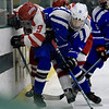 Leominster High School Hockey played Fitchburg/Monty Tech during the Mark Bushnoe Memorial Christmas Tournament on Thursday, December 27, 2018 at the Wallace Civic Center, Fitchburg. Fitchburg's Jake Thibeault and LHS's Colby Doiron fight for control of the puck. SENTINEL & ENTERPRISE/JOHN LOVE