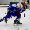 Leominster High School Hockey played Fitchburg/Monty Tech during the Mark Bushnoe Memorial Christmas Tournament on Thursday, December 27, 2018 at the Wallace Civic Center, Fitchburg. Fitchburg's Max Beaulac and LHS's Maliq Munoz-Preko fight for control of the puck. SENTINEL & ENTERPRISE/JOHN LOVE