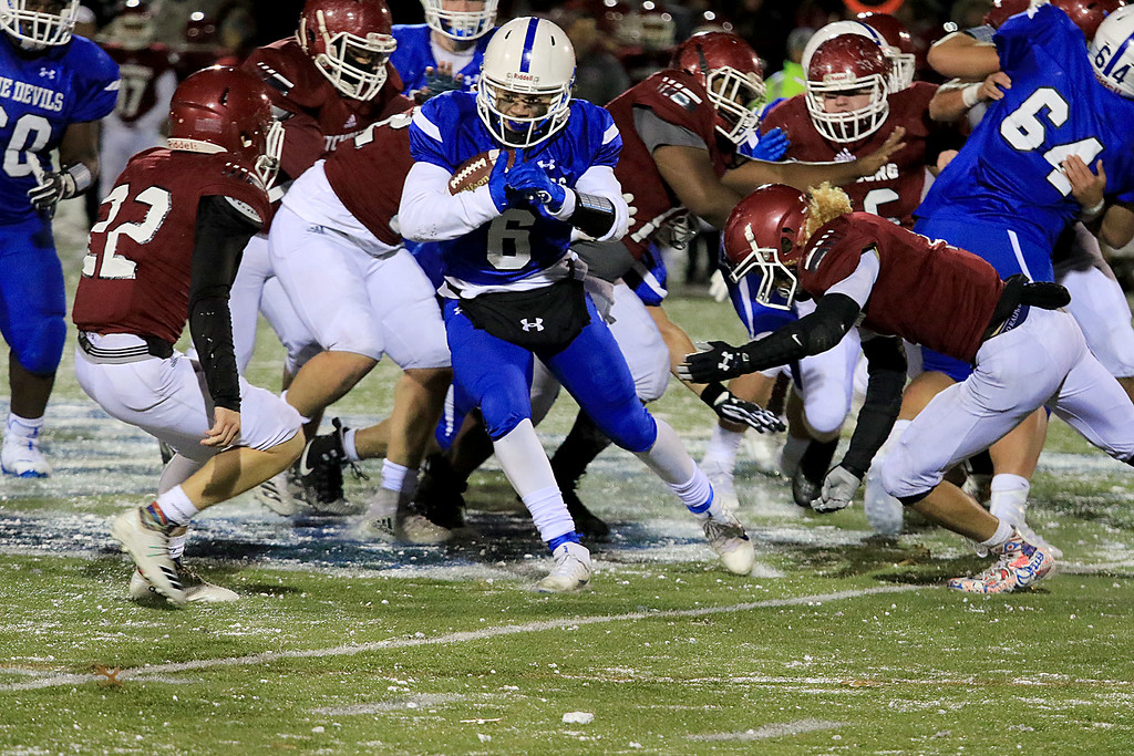 . The Thanksgiving day game with Leominster High School vs Fitchburg High School was played at  Doyle Field in Leomiinster on Wednesday night, November 21, 2018. LHS\'s JC Cora Jr. tries to make it through the FHS\'s defense. . SENTINEL & ENTERPRISE/JOHN LOVE