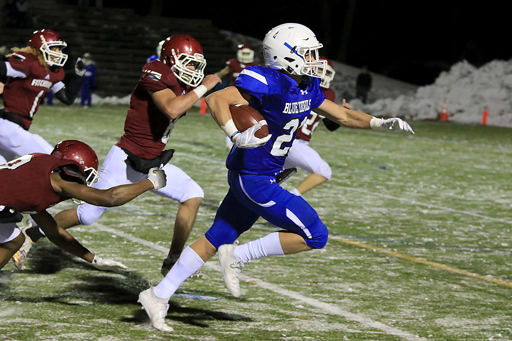 . The Thanksgiving day game with Leominster High School vs Fitchburg High School was played at  Doyle Field in Leomiinster on Wednesday night, November 21, 2018. LHS Adam Couch finds some room to run for a touchdown. SENTINEL & ENTERPRISE/JOHN LOVE