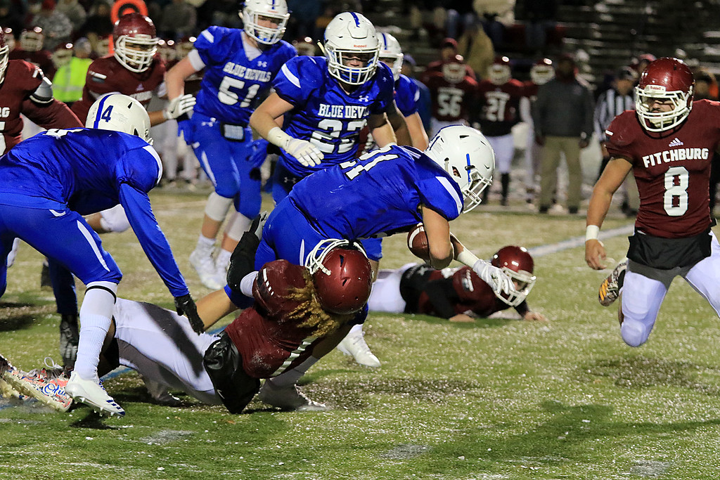 . The Thanksgiving day game with Leominster High School vs Fitchburg High School was played at  Doyle Field in Leomiinster on Wednesday night, November 21, 2018. FHS\'s Trey Winters tackles LHS\'s Adam Couch. SENTINEL & ENTERPRISE/JOHN LOVE